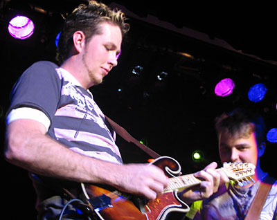 Josh Grundy (on Tomkins mandolin) and Travis Collins